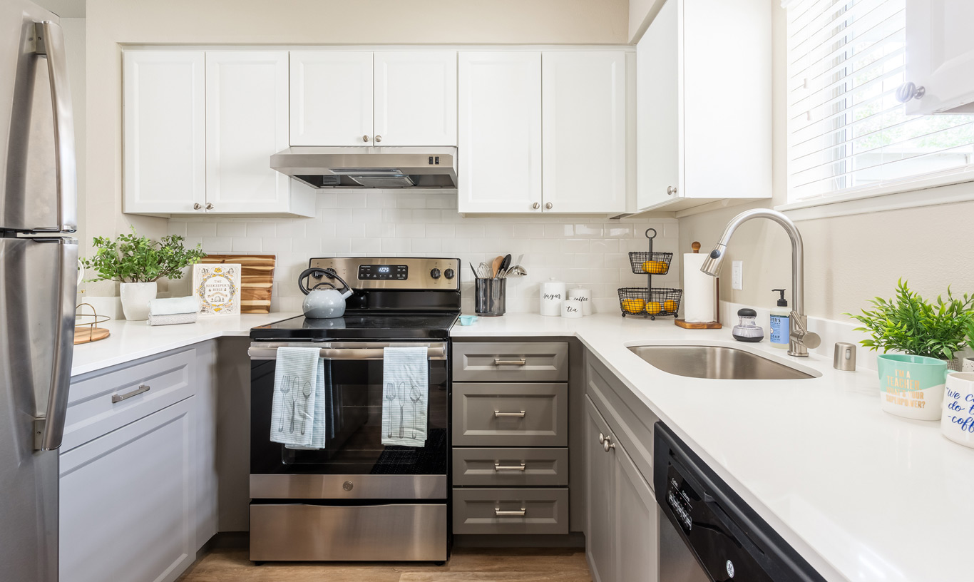 The kitchen at Lighthouse Apartments features stainless appliances.