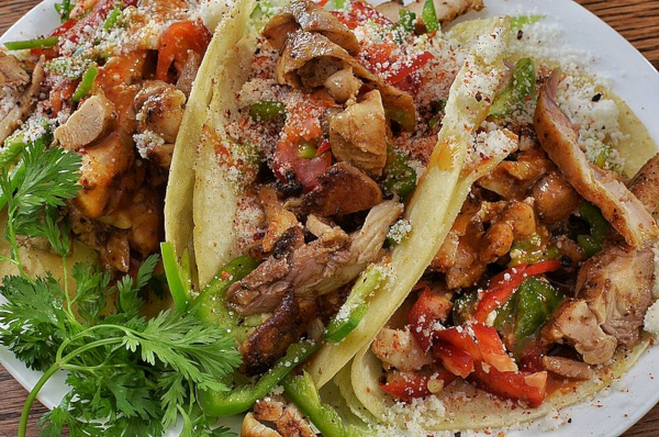 chicken tacos with peppers on corn tortilla with cheese