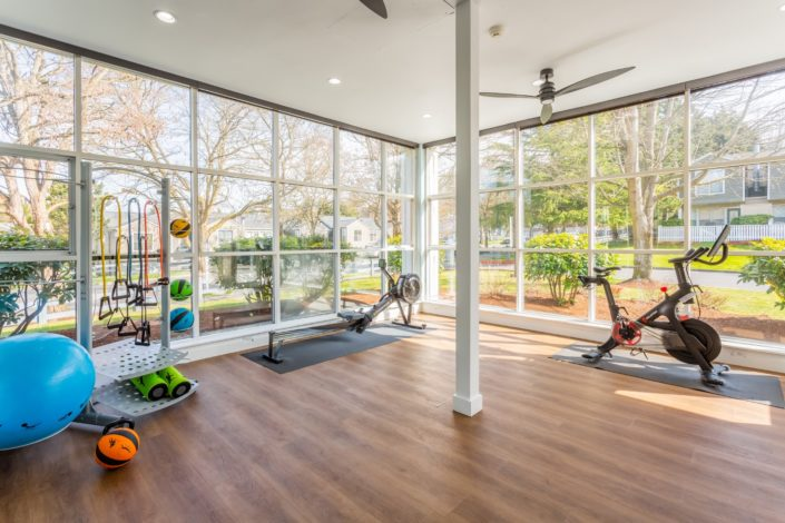 This exercise room is surrounded by windows.
