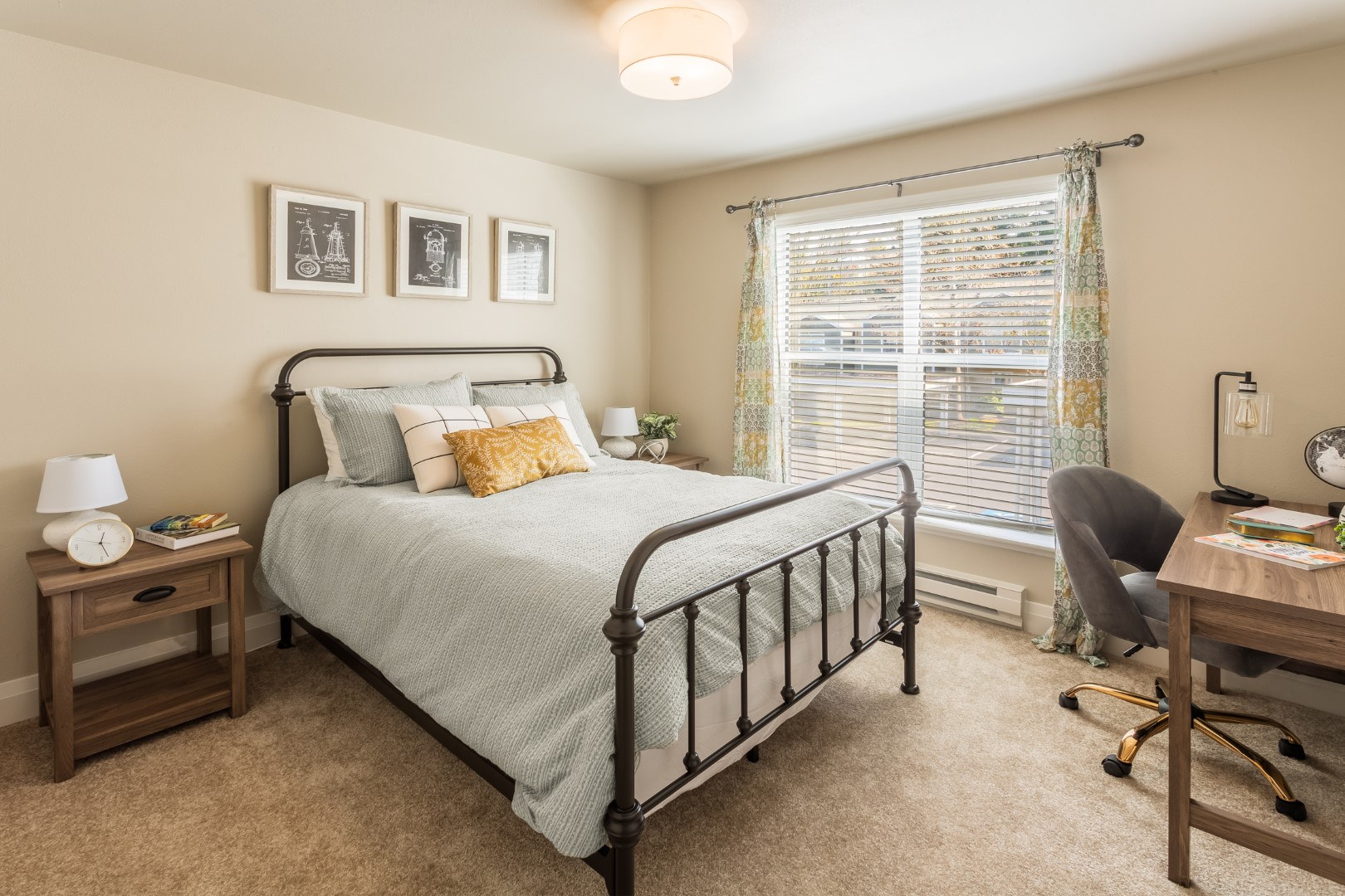 A made bed is well lit in this daylight bedroom.