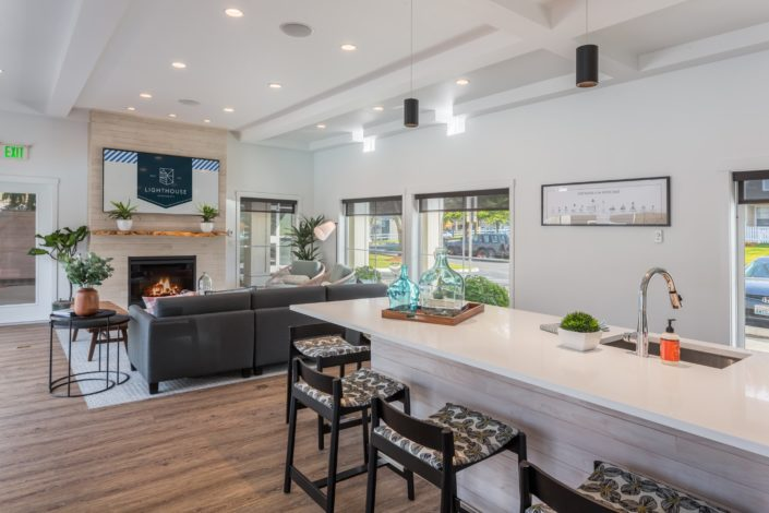 The common area at Lighthouse Apartments has a kitchen and living room.